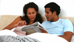 Couple reading a newspaper Footage