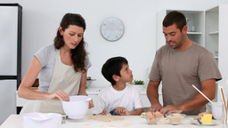 Family cooking together at home Stock Video Footage