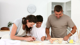 Family cooking together in the kitchen Stock Video Footage