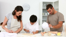 Family Cooking Together In The Kitchen stock footage
