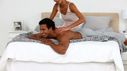 Woman massaging her husband Footage
