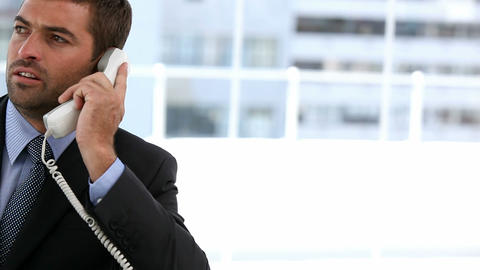 Businessman talking on phone Footage