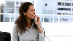 Businesswoman talking on phone in office Footage