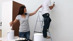 Couple making renovation work Footage