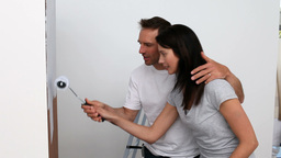 Man teaching to his wife the art of the brush Stock Video Footage