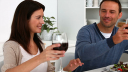 Couple toasting with red wine during the lunch Stock Video Footage