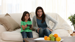 Mother and daughter playing video games Footage