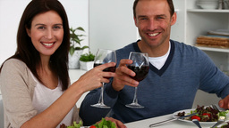 Couple have a happy dinner looking at the camera Stock Video Footage