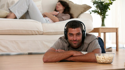 Man at Home listening to music on the ground Footage