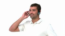 Handsome man listening music Footage