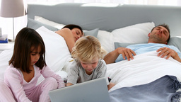 Attentive children using a laptop while their pare Footage