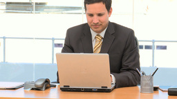 Businessman working on a laptop Footage