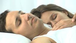 Beautiful couple sleeping together in the bed Footage