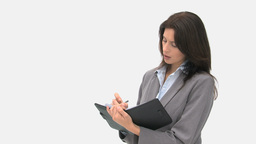 Businesswoman writing on her agenda Stock Video Footage