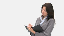 Businesswoman writing on her agenda Footage