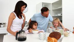Cute family enjoying breakfast together Footage