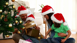 Cute family opening Christmas presents sitting on Stock Video Footage