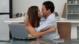 Lovely happy couple looking at the laptop sitting  Footage