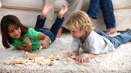 Children playing on the carpet Stock Video Footage