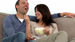 Happy couple watching television Stock Video Footage