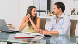 Worried couple calculating their bills Footage