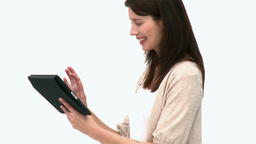 Beautiful woman using a computer tablet Footage