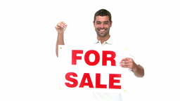 Man showing a for sale sign Footage