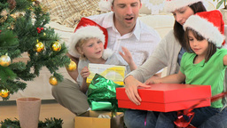Lovely family opening Christmas presents Footage