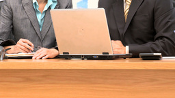 Business people working together with a laptop and Stock Video Footage