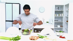Man preparing a salad for lunch Stock Video Footage