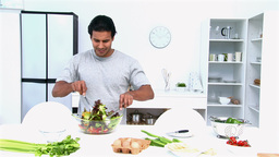 Man preparing a salad for lunch Footage