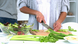 Woman cooking vegetables Stock Video Footage