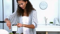 Woman preparing a salad Footage