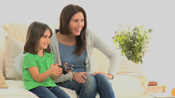 Sweet little girl playing with her mother Stock Video Footage