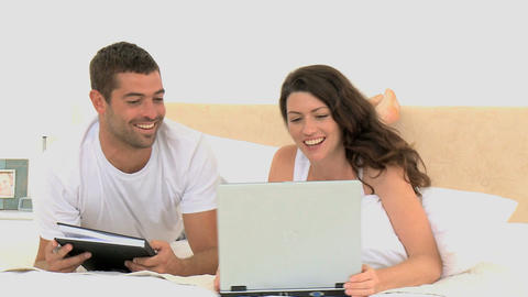 Couple laughing after watching a video on the lapt Footage