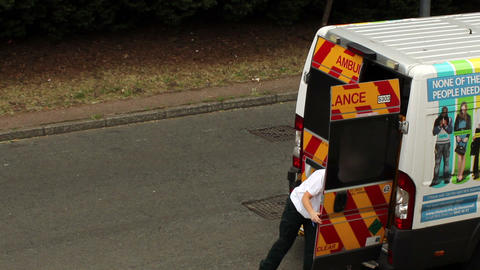 Female Paramedic Closes The Door Of The Ambulance stock footage