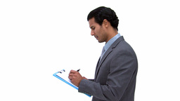 Businessman writting on a notebook Stock Video Footage