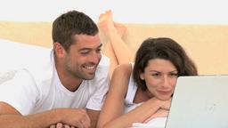 Happy couple using laptop Footage