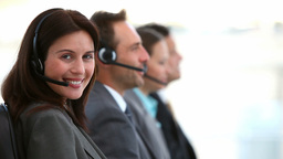 Smiling customer service agents working in a call  Footage