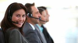Smiling customer service agents working in a call Stock Video Footage