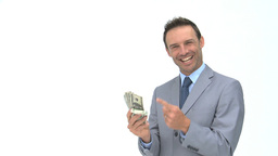 Smiling businessman holding dollars Footage