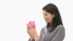 Smiling businesswoman holding a piggy bank Footage