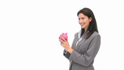 Businesswoman holding a piggy bank Footage