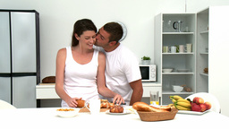 Man hugging his wife before they having breakfast Stock Video Footage