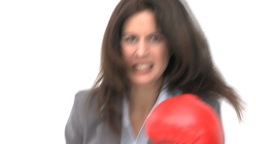 Serious businesswoman with boxing gloves Footage