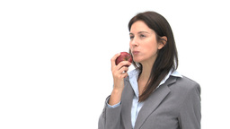 Businesswoman eating an apple Footage