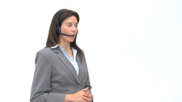 Smiling businesswoman talking with headphones Stock Video Footage