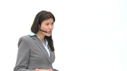 Annoyed businesswoman talking with headphones Stock Video Footage