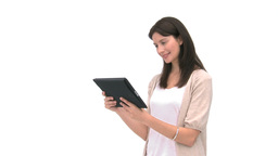 Smiling woman using a computer tablet Footage