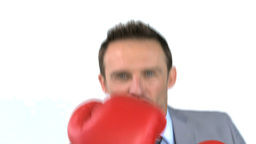 Smiling businessman with boxing gloves Footage